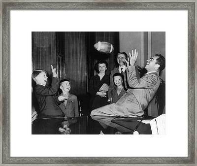 Nixon Catching Football Framed Print by Underwood Archives