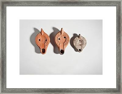 North African Terracotta Oil Lamps Framed Print by Science Photo Library