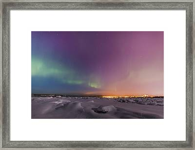 Northern Lights Shine Above City Framed Print by Kevin Smith