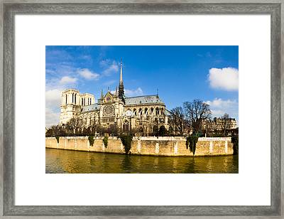 Notre Dame De Paris And The River Seine Framed Print by Mark E Tisdale