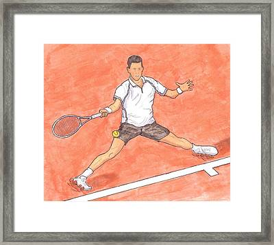 Novak Djokovic Sliding On Clay Framed Print by Steven White