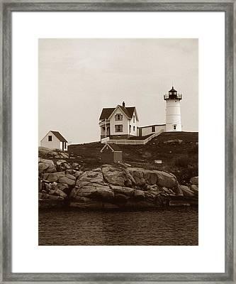 Nubble Light Framed Print by Skip Willits