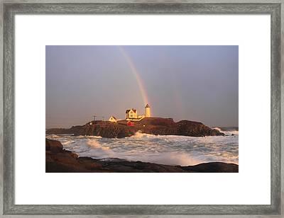 Nubble Lighthouse Rainbow And High Surf Framed Print by John Burk