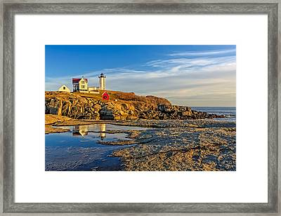 Nubble Lighthouse Reflections Framed Print by Susan Candelario