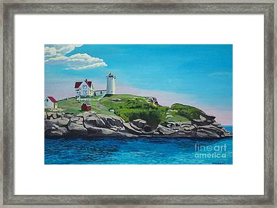 Nubble Lighthouse Sunrise Framed Print by Stella Sherman