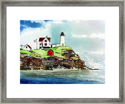 Nubble Lighthouse Framed Print by Tom Riggs