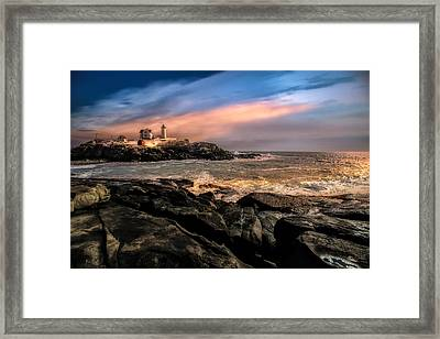 Nubble Lighthouse Winter Solstice Sunset Framed Print by Bob Orsillo