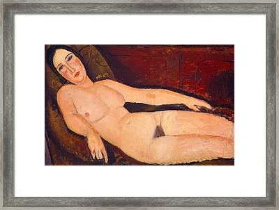 Nude On A Divan Framed Print by Amedeo Modigliani
