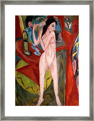 Nude Woman Combing Her Hair Framed Print by Ernst Ludwig Kirchner