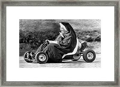 Nun On A Go-kart Framed Print by Underwood Archives
