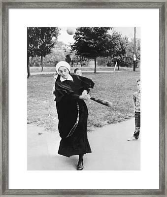 Nun Swinging A Baseball Bat Framed Print by Underwood Archives