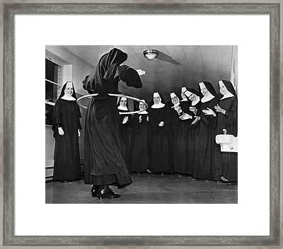 Nun Swivels Hula Hoop On Hips Framed Print by Underwood Archives