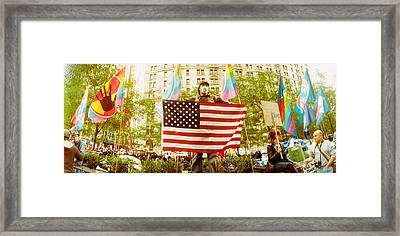 Occupy Wall Street Protester Holding Framed Print by Panoramic Images