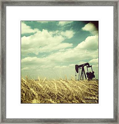 Oil Boom Framed Print by Becky Gossett