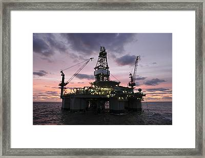 Oil Rig At Dawn Framed Print by Bradford Martin