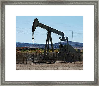 Oil Well  Pumper Framed Print by Dany Lison