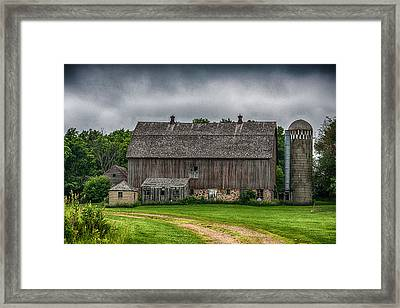 Old Barn On A Stormy Day Framed Print by Paul Freidlund