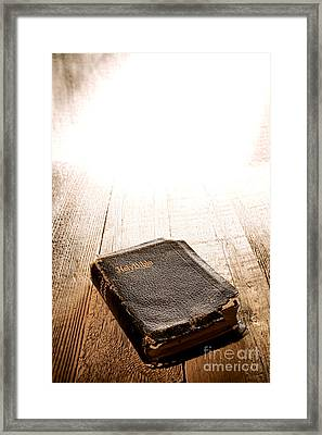 Old Bible In Divine Light Framed Print by Olivier Le Queinec