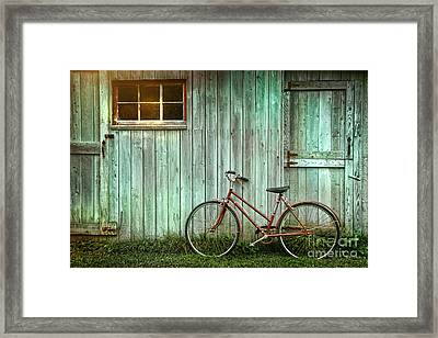 Old Bicycle Leaning Against Grungy Barn Framed Print by Sandra Cunningham