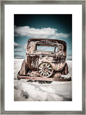 Old Car In The Snow Framed Print by Edward Fielding
