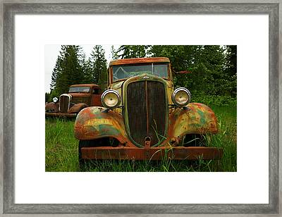 Old Cars Left To Decorate The Weeds Framed Print by Jeff Swan