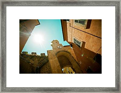 Old Clock On The Tower And Sun Framed Print by Raimond Klavins
