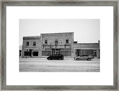 old empty stores brick historic buildings 3rd ave Kamsack Saskatchewan Canada Framed Print by Joe Fox