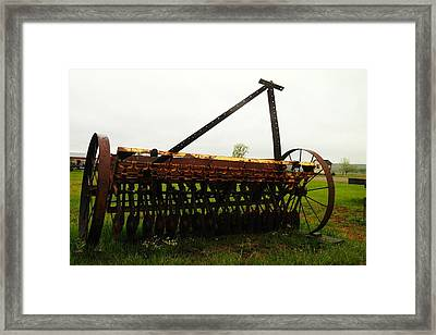 Old Farm Equipment Framed Print by Jeff Swan