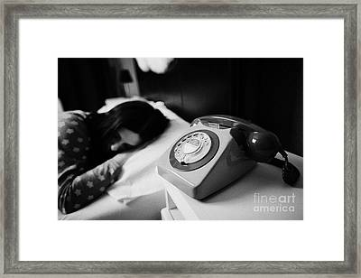 Old Fashioned Gpo Bt Phone On Bedside Table Of Early Twenties Woman In Bed In A Bedroom Framed Print by Joe Fox