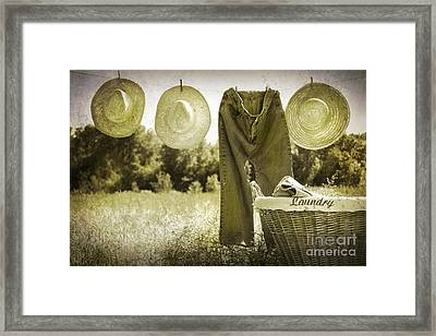 Old Grunge Photo Of Jeans And Straw Hats  Framed Print by Sandra Cunningham