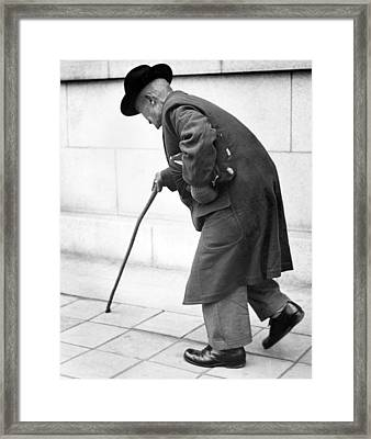 Old Man Walking With A Cane Framed Print by Underwood Archives