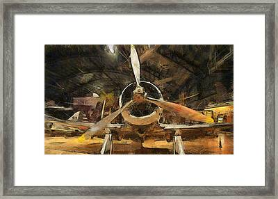 Old Plane In The Hangar Framed Print by Dan Sproul