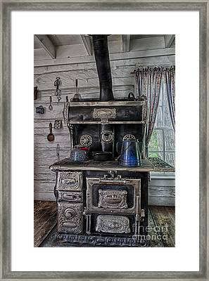 Old Stove Framed Print by Darcy Michaelchuk