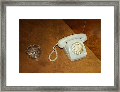 Old Telephone And Ashtray On Brown Table Framed Print by Matthias Hauser