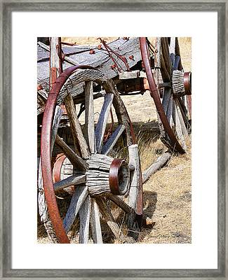 Old Wagon Wheels From Montana Framed Print by Jennie Marie Schell