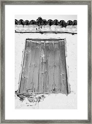 old weathered brown wooden door double window opening on abandoned house with cracked stucco yellow walls in Tacoronte Tenerife Canary Islands Spain Framed Print by Joe Fox