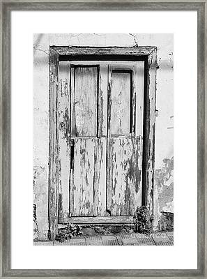 old weathered green painted wooden door entrance to abandoned house with cracked stucco walls in Tacoronte Tenerife Canary Islands Spain Framed Print by Joe Fox