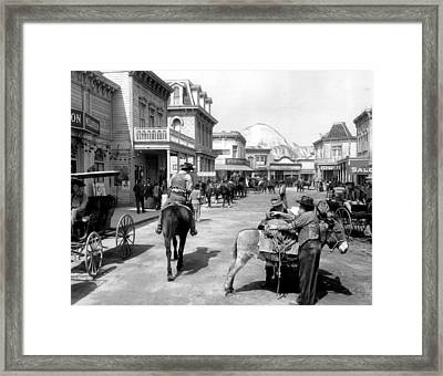 Old West Scene Framed Print by Retro Images Archive