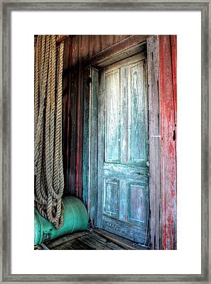 Old Wooden Door Framed Print by Lynn Jordan