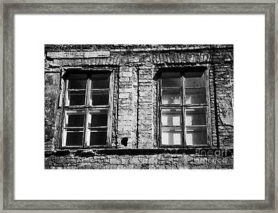 Old Wooden Double Layer Glazing In Old Red Brick Building With Plaster Facade Removed For Renovation Kazimierz Krakow Framed Print by Joe Fox