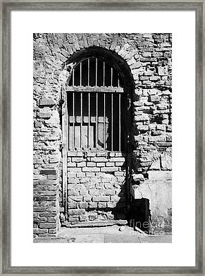 Old Wooden Framed Window With Weathered Steel Bars Door Replacement In Red Brick Building With Plaster Removed Krakow Framed Print by Joe Fox
