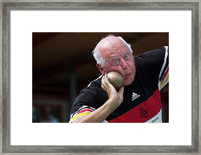 Older Man About To Throw Shot Put Framed Print by Alex Rotas