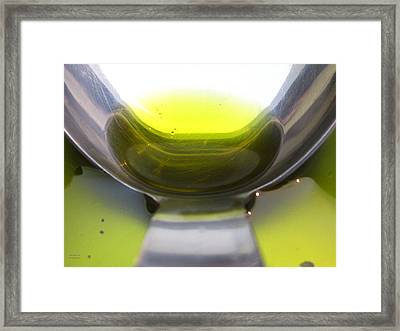 Olive Oil In A Ladle Framed Print by Alexandros Daskalakis