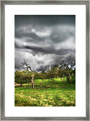 Ominous Storm Brewing Framed Print by Abram House