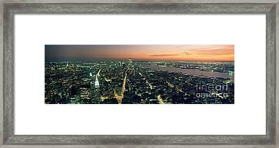 On Top Of The City Framed Print by Jon Neidert