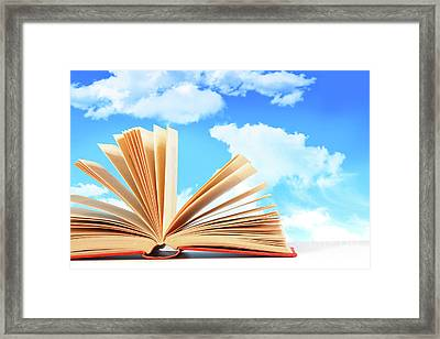Open Book Against A Blue Sky Framed Print by Sandra Cunningham