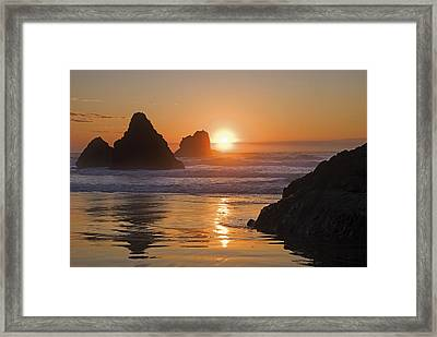 Orange Sunset Behind Offshore Rocks Framed Print by Philippe Widling