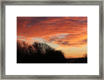 Orange Tracks Framed Print by Cary Amos
