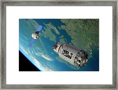 Orbital Maintenance Docking Framed Print by Walter Myers