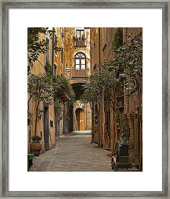 Orvieto Side Street Framed Print by Lynn Andrews